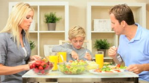 stock-footage-young-caucasian-family-sharing-a-healthy-lunch-together