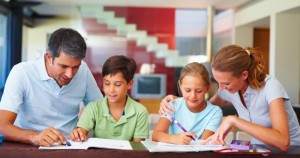 Children with their parents assisting them in the homework